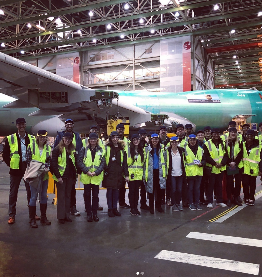 Last stop in the #pnw, @boeing ✈️! For an #avgeek like me, touring the world renowned Everett factory was quite a treat. This is where the 747, 767, 777, and 787 planes are made 🛩.   At 472M cubic feet needed to house these manufacturing lines, the Everett factory is the largest building in the world.   ✅Coolest part of the day: flying the 787 Dreamliner simulator 👨✈️👩✈️💺💻🛫.   #LGOonthego #DPT2019 #LGO20 #sloaniedayinthelife #thatLGOlife #mymitsloan